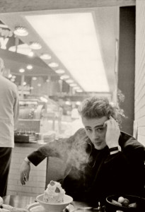 James Dean with cake (photographed by Dennis Stock in NYC).