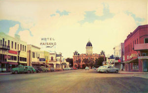 From a 1960s postcard, the El Paisano hotel visible on the right.