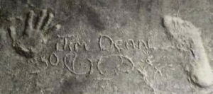 Young Jim's hand and footprints in the concrete inside the barn.